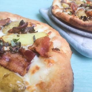 Homemade Pizza with Bacon, Potatoes, Radicchio and Smoked Mozzarella