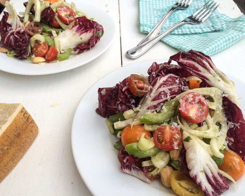 Radicchio Salad with Celery, Fennel, Tomatoes and Marcona Almonds with a Basil-Anchovy Dressing