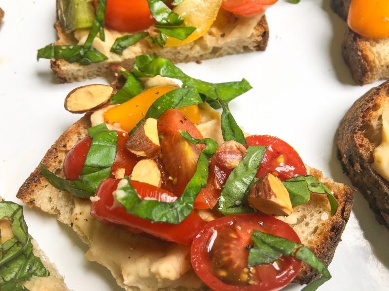 Tomato Bruschetta with White Bean Puree and Smoked Almonds
