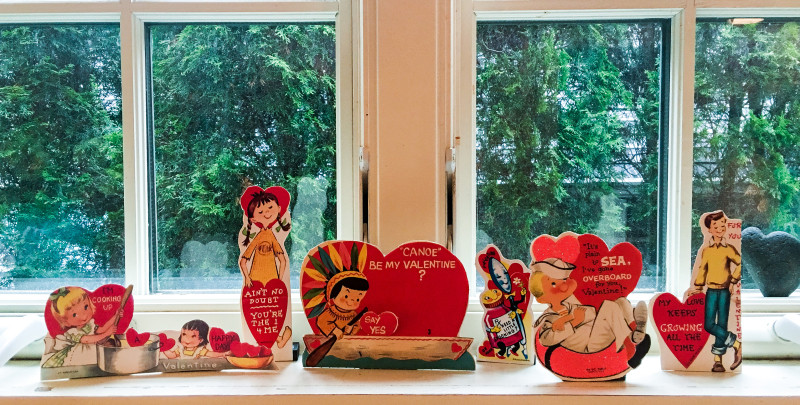 Vintage Valentines Day cards in window