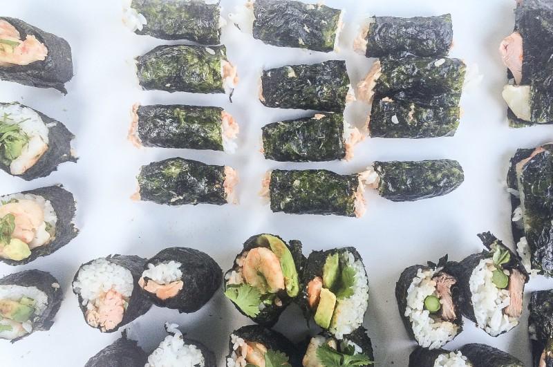 Homemade Sushi Rolls with Shrimp, Avocado, Steak and Salmon