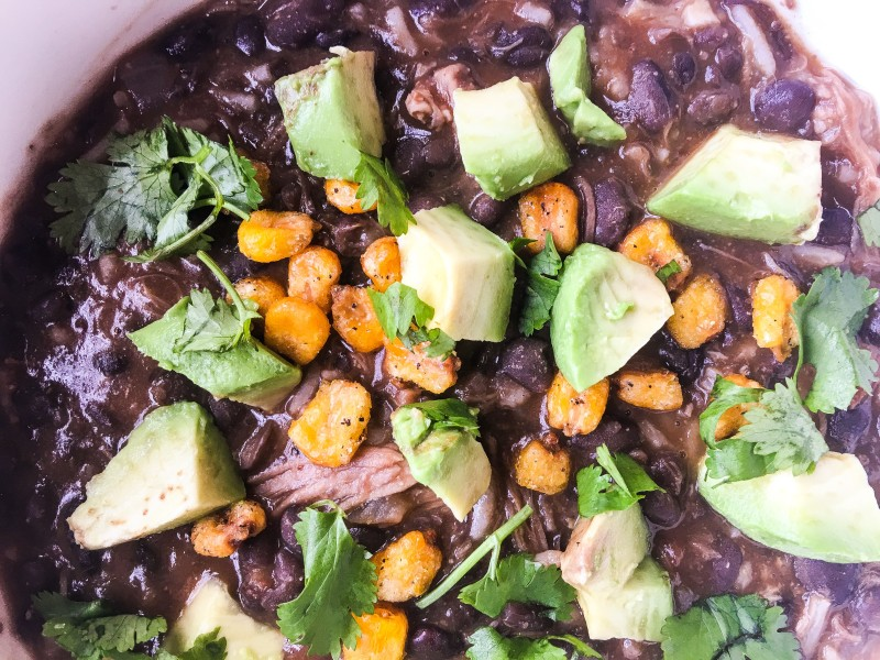 Black Bean and Pork Soup with Avocado and COrn nuts