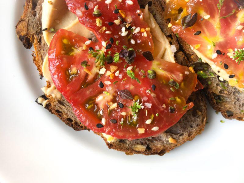 hummus on walnut bread with tomatoes