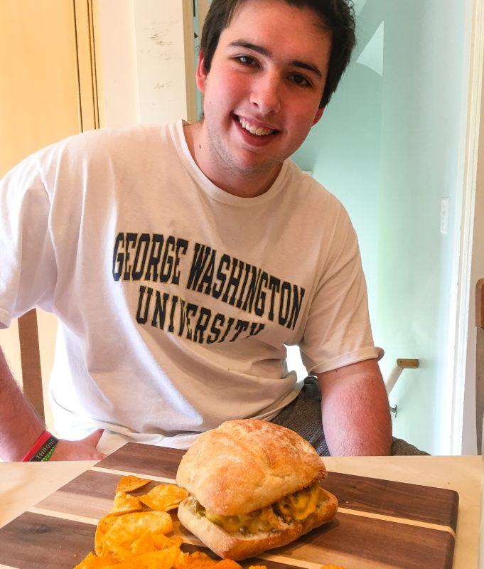 Oliver cooking burger
