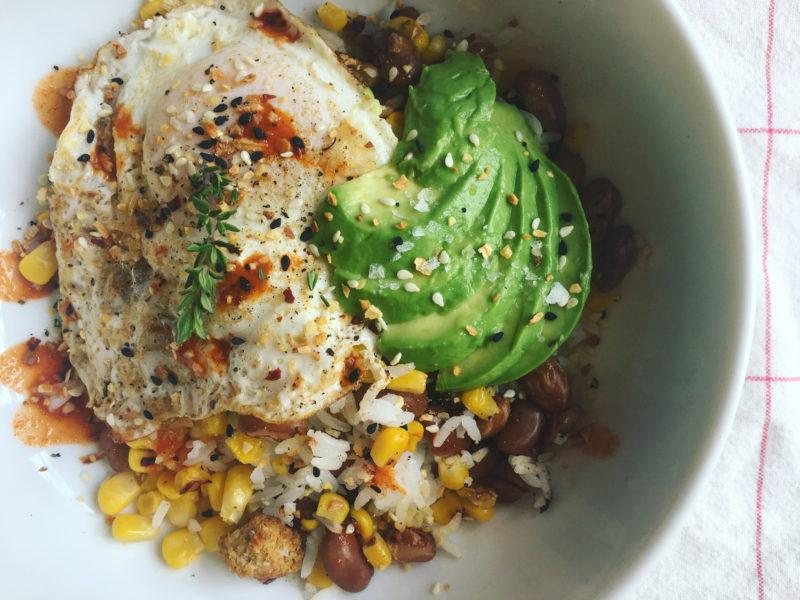 rice bowl with beans, egg,avocado, corn